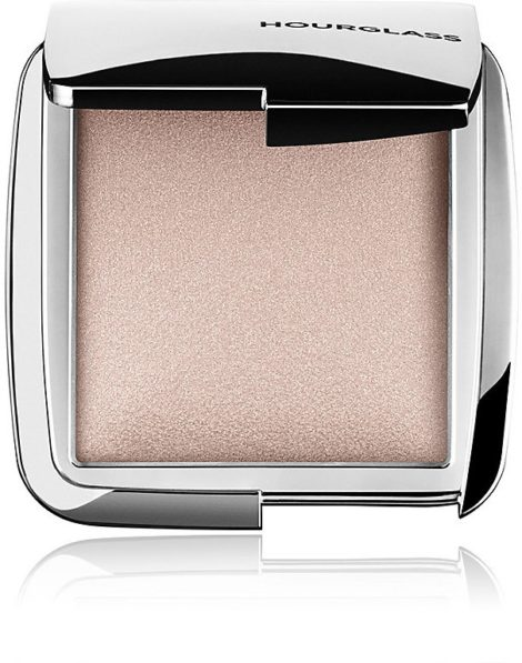 HOURGLASS INCANDESCENT STROBE LIGHT: An opalescent pearl powder imparting a celestial highlight. designed to sculpt the face with light creating depth and dimension for a refined, natural highlight.